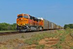 BNSF 7060 and 4193 heads up a wb rack train with all new ford's